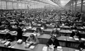 Staff check football pools coupons in 1947.