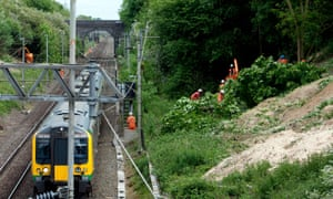 Engineers cut down trees beside the West Coast Main Line, Northamptonshire.
