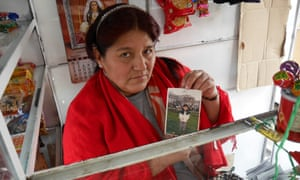 Rosa Rojas Borda with a picture of her late son Javier, who was killed by a paramilitary death squad when he was eight years old.