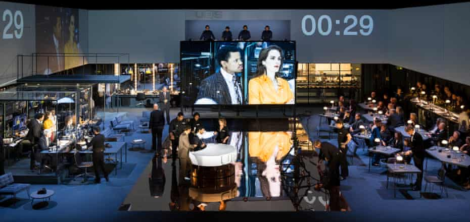 The stage is transformed into a studio … Tunji Kasim and Michelle Dockery (on screen) in Network.