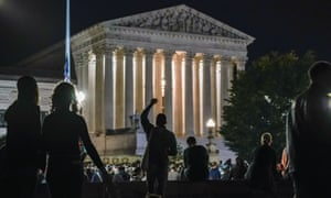 People gather at the supreme court in Washington DC to honor the late Ruth Bader Ginsburg on Saturday.