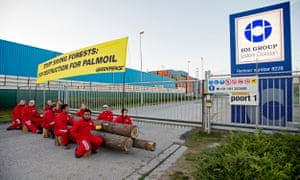 Greenpeace activists close off access for all imports and exports from palm oil trader IOI in the harbour of Rotterdam.