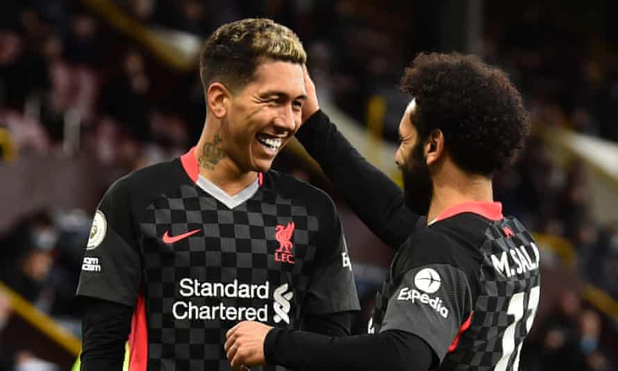 Roberto Firmino celebrates with Mohamed Salah after scoring in Liverpool's win at Burnley on Wednesday. Liverpool are at home to Crystal Palace on Sunday.