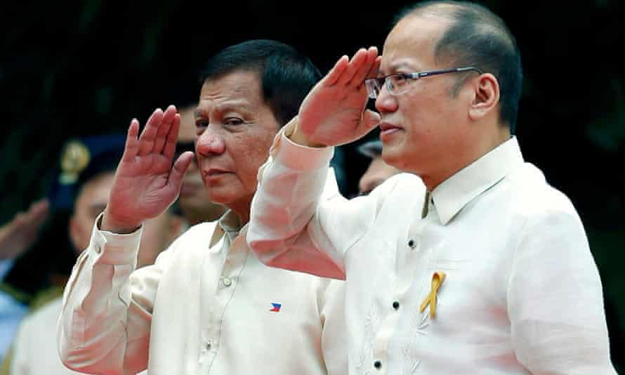 Rodrigo Duterte takes the salute during his inauguration ceremony alongside the Philippines' outgoing president, Benigno Aquino.