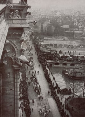 A 1910 image by Léon Gimpel showing the Notre Dame's gargoyles looking down on the mid-Lent carnival