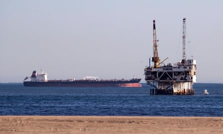 A tanker next to an offshore drilling platform in Huntington Beach, California. US taxpayers subsidize the fossil fuel industry at roughly $20bn per year.