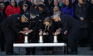 Mayor Sadiq Khan, right, with the home secretary, Amber Rudd, lights a candle in Trafalgar Square, Thursday.