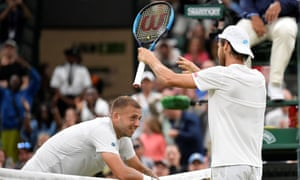 Portugal's João Sousa celebrates winning his epic tussle with Dan Evbans after the Briton put an attempted drop shot into the net.
