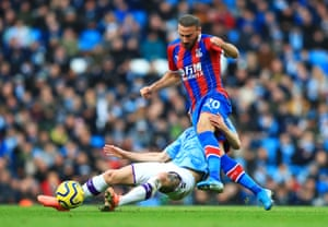 Crystal Palace's Cenk Tosun takes on John Stones of Manchester City during the Premier League match on 18 January.