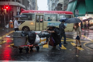 Hong Kong, China A worker pushes a trolley loaded with garbage