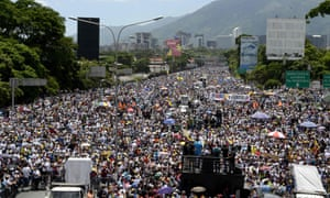 Activists block a major motorway in eastern Caracas on 20 May in protest against the government of President Maduro.