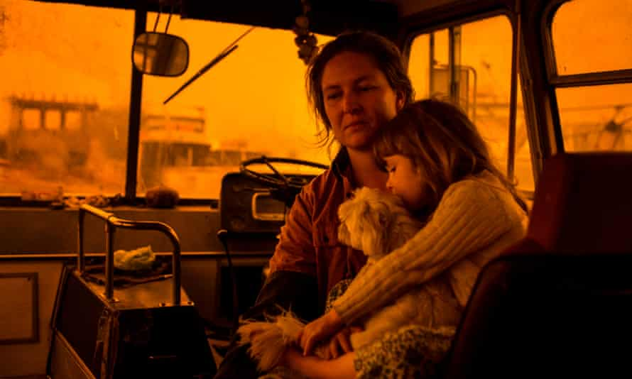 Shelley Tratham-Webb and daughter Pearl in the bus where they had to live after evacuating their home in the face of bushfires in Nethercote, New South Wales.