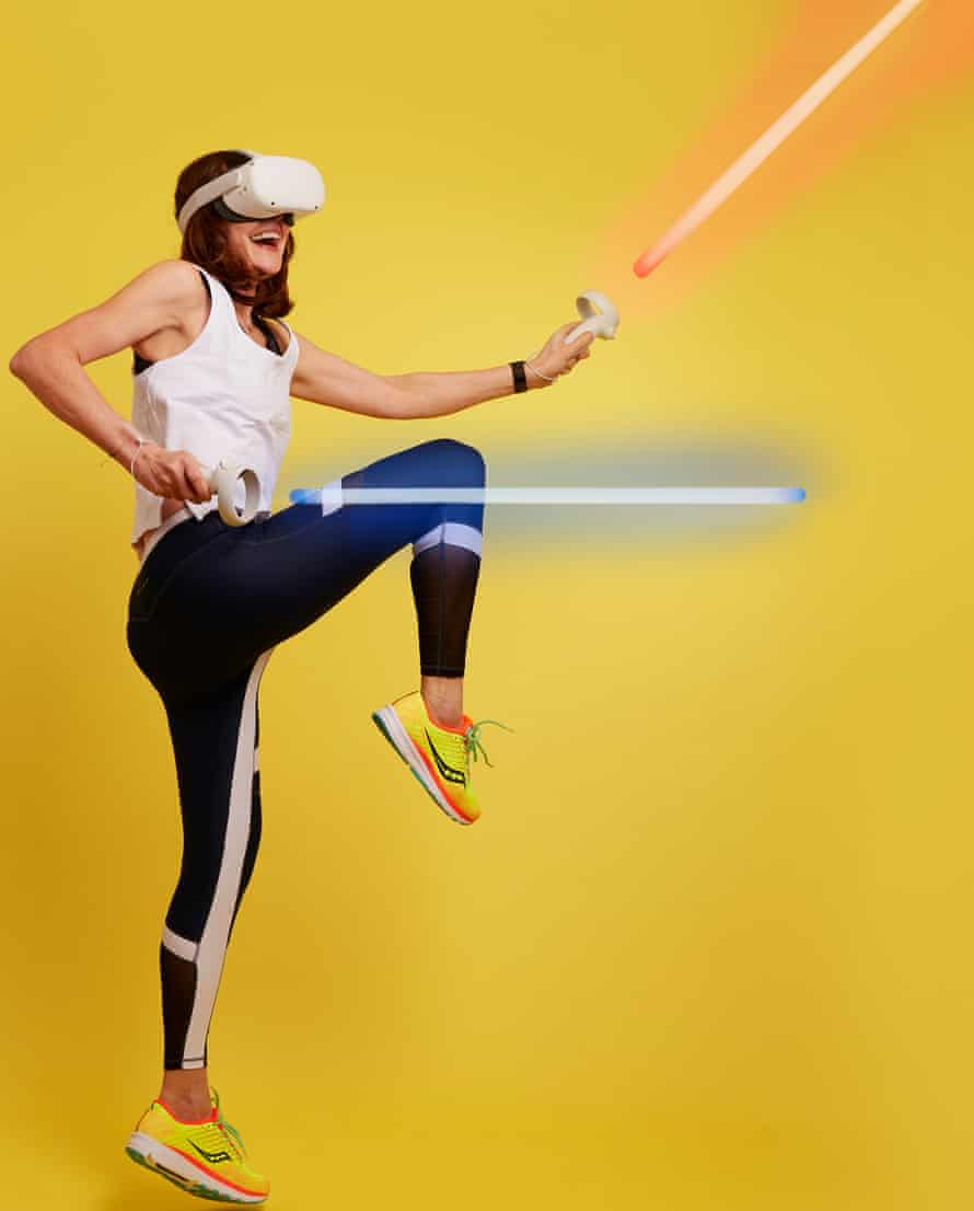 Zoe Williams with light sabres
