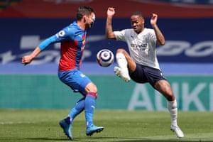 Raheem Sterling under pressure from Joel Ward.