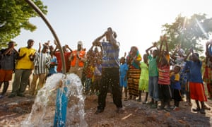 A community celebrates their new borehole − the 1,500th World Vision has drilled in Mali.