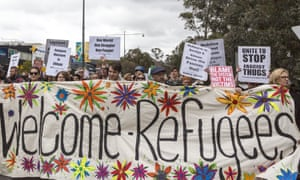 Refugee supporters rally in Melbourne. Many Australian employers mistakenly assume hiring refugees is fraught with challenges