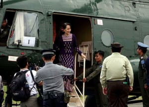 Aung San Suu Kyi visits Sittwe, in western Myanmar, after unrest in which many Rohingya died. Photograph: Nyunt Win/EPA