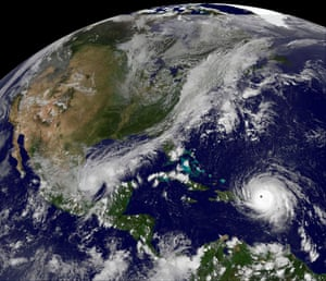 Hurricane Irma, a category five storm, churns across the Atlantic Ocean past Puerto Rico and the over Dominican Republic.