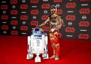 """""""R2-D2"""" and """"C-3PO"""" walk the red carpet."""