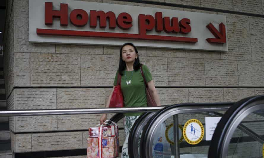 A woman walks out from a branch of Homeplus in Seoul, South Korea.