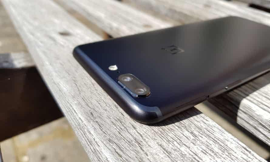 The dual-camera lump on the back and the antenna band running around the top.