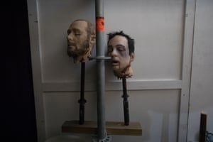 Two plastic heads on sticks