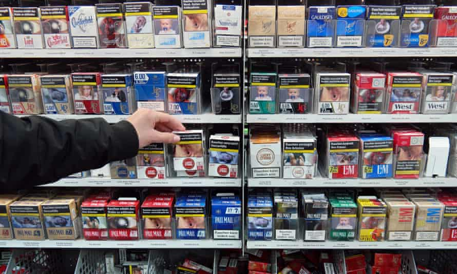 Cigarettes in a supermarket featuring the EU's graphic health warnings