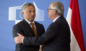 European Commission President Jean-Claude Juncker, right, greets Hungarian prime minister Viktor Orbán before a meeting in Brussels about the migration crisis.