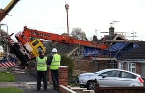 Basingstoke, England A crane is hoisted upright