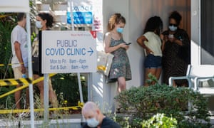People wait in line to be tested for Covid at Royal Perth Hospital in Perth on Sunday after authorities announced a snap five-day lockdown.