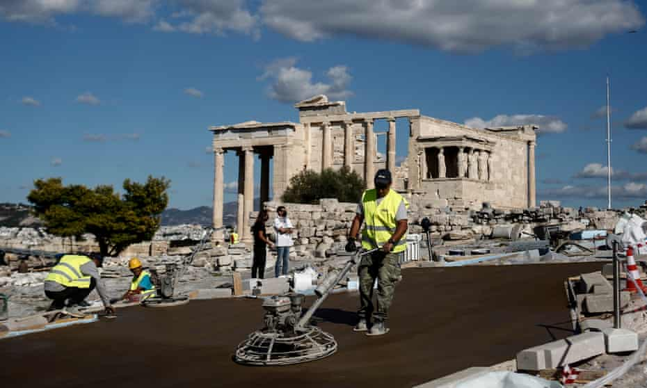 Workers are cementing the pathway to the Parthenon temple in Athens.