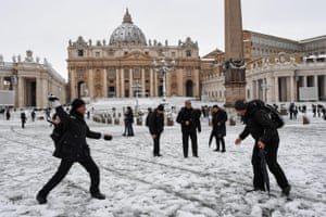 People enjoying a snowball fight outside the Vatican.