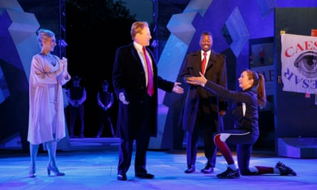 Tina Benko, left, portrays Melania Trump in the role of Caesar's wife, Calpurnia, and Gregg Henry, center left, portrays President Donald Trump in the role of Julius Caesar during a dress rehearsal of The Public Theater's Free Shakespeare in the Park production of Julius Caesar in New York.