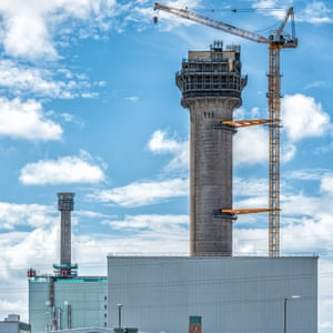 A crane dismantling a tower in the oldest corner of the Sellafield site