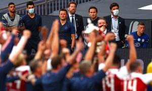 Frank Lampard and his Chelsea players and staff look on as Arsenal lift the FA Cup at Wembley.