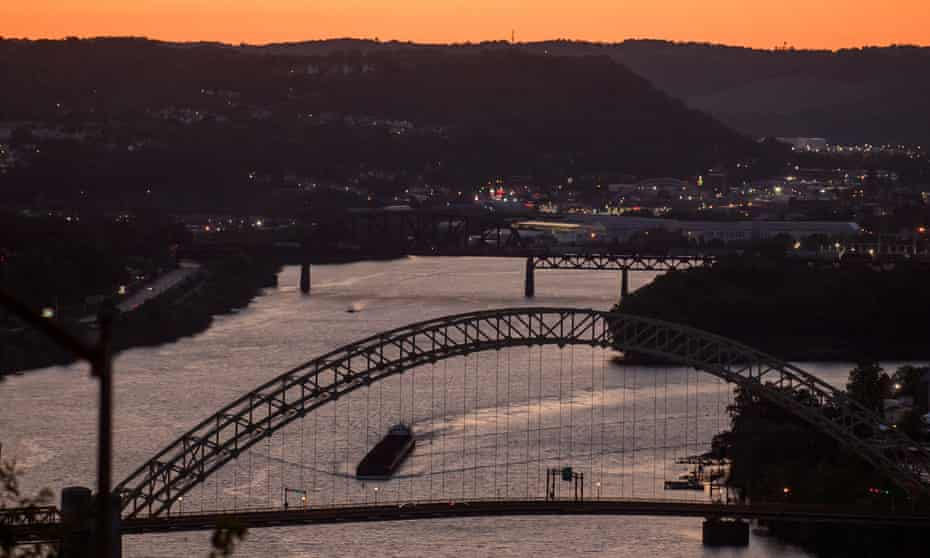 A coal barge makes its way up the Ohio River in Pittsburgh this August.