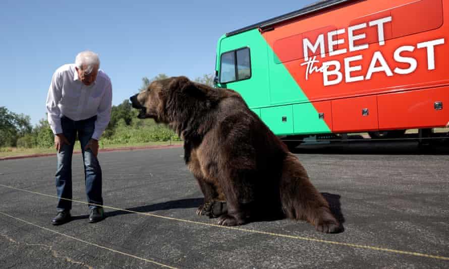 John Cox greets a bear.
