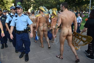 Participants walk past police before the start of the Sydney Gay and Lesbian Mardi Gras Parade in Sydney on 7 March. Around 10,000 people took part in the 37th annual parade.