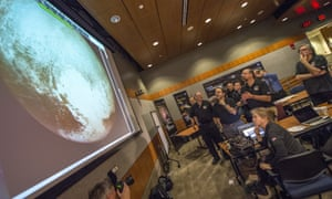 Members of the New Horizons team view the spacecraft's last and sharpest image of Pluto before its closest approach.