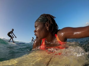 """Khadjou surfs during a training session. """"When I am in the water I feel something extraordinary, something special in my heart,"""" said Sambe"""