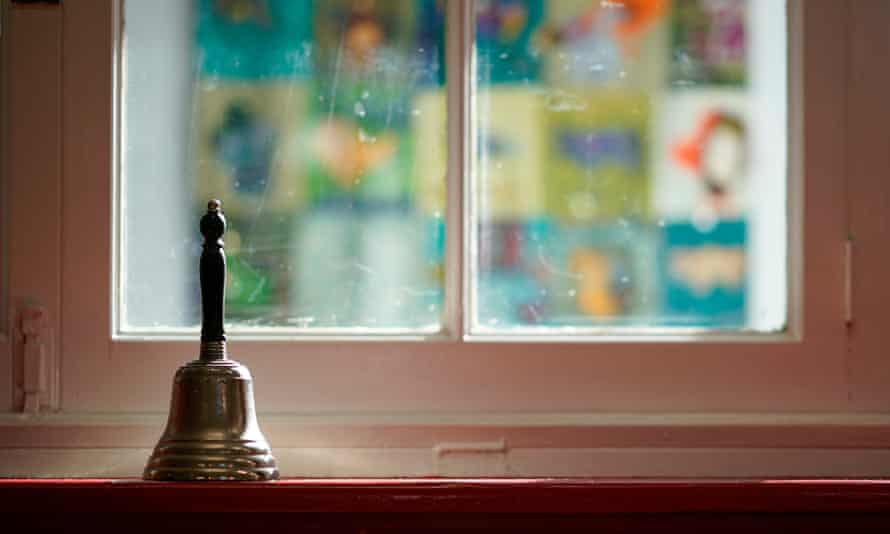 The school bell sits dormant on a window sill