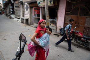 A woman carries a child to Sagar clinic.
