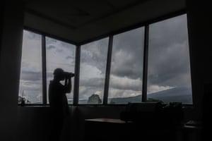 Officials monitor the eruption of Mount Semeru