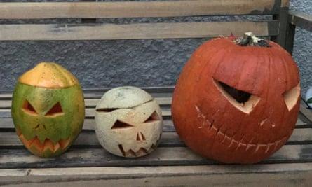 A carved papaya, rockmelon and pumpkin.