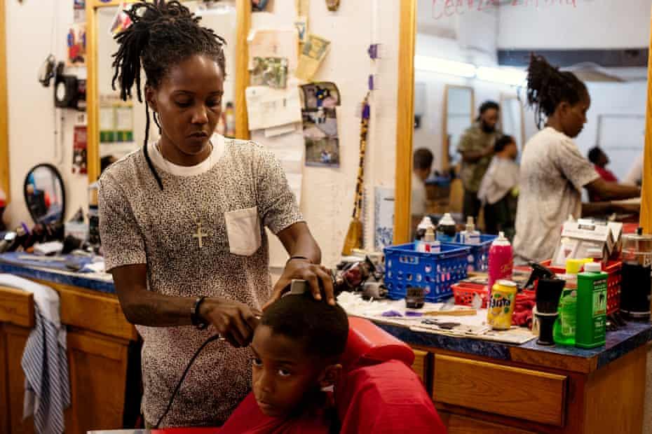 Celeste Coleman gives Jace Noah a hair cut at Kutt'n Korners barbershop in the Scotlandville neighborhood of Baton Rouge.