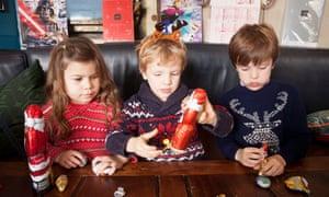 Laura Rosa, Falco and Mannix cast their expert eyes over a chocolate santa.