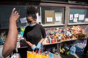 People collect donations for the families affected by the Grenfell Tower fire