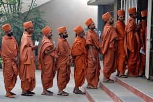 Ahmedabad, India Hindu saints queue to cast their votes