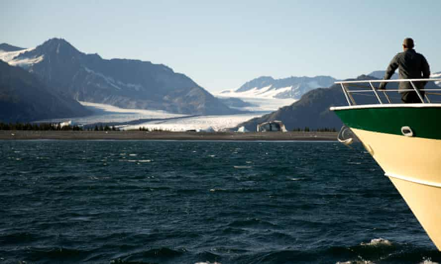 President Barack Obama looks at Bear Glacier, which has receded 1.8 miles in approximately 100 years, while on a boat tour to see the effects of global warming in Seward, Alaska.