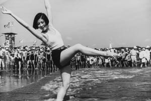 """The calm before the storm"". A girl dancing on Yuigahama Beach in Kamakura 1934. Kineo Kuwabara's images were unknown outside a small circle until his large retrospective in 1973. It was the first time that photographs from 1930's were shown publicly in Japan and for many survivors of the war his photographs were a source of great nostalgia"